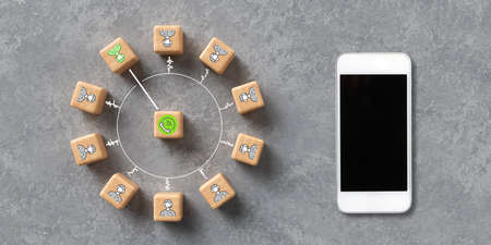 cubes with icons symbolizing a call center and a smartphone on concrete background Zdjęcie Seryjne