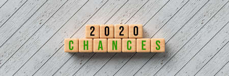 cubes with message 2020 CHANCES on wooden background - 3d illustration Stock Photo