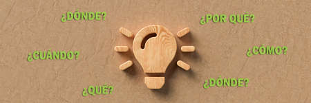 wooden lightbulb with the Spanish words for WHEN, WHAT, WHERE, WHO, WHY and HOW on paper background - 3d illustration Banque d'images