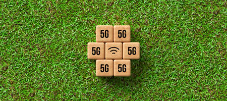 cubes with 5G and WLAN symbol on grass background - 3d illustration Stock Photo