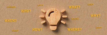 wooden lightbulb with the words WHEN, WHAT, WHERE, WHO, WHY and HOW on paper background - 3d illustration