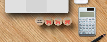 cubes with shopping icons, a laptop and a calculator on wooden background