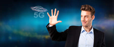 businessman with message 5G on abstract blue background