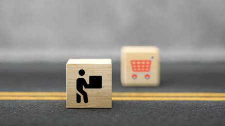 cubes with shopping icons on asphalt background - 3d illustration 版權商用圖片