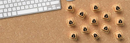 cubes with bitcoin symbols and a keyboard on cork surface