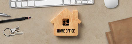 wooden house symbol with message HOME OFFICE and office equipment on paper background