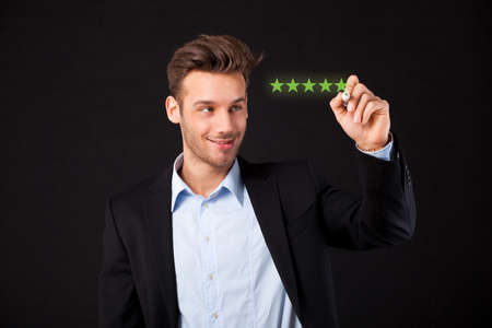 businesswoman writing 5 stars on a virtual screen in front of black background