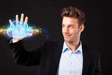 businessman presenting a virtual cloud with a world map in front of black background