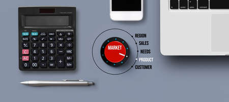 Business marketing research analysis and consumerism concept with a central red dial with the steps in the process surrounded by calculator, laptop, mobile phone and pen in a flat lay still life