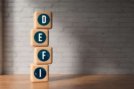 cubes with message DEFI on wooden surface in front of a brick wall background - 3d illustration