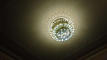 pendant lamp: The working chandelier on a room ceiling