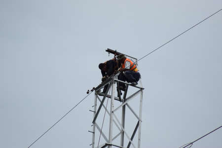 lineman: Electrician lineman repairman worker at climbing work on electric post power pole