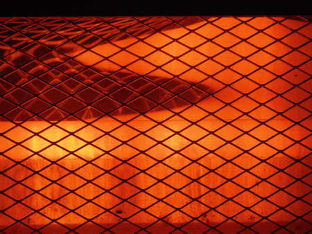 electric grid: electric heater. a protective grid and a reflector on a heater. Stock Photo