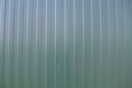 metal wall: Diagonal pattern of metal profile. Fences from the galvanized iron painted by a polymeric covering.