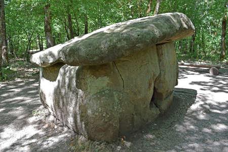 kuban: Big Shapsug dolmen. A megalytic construction in the woods of Kuban. Stock Photo