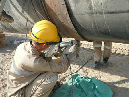 pipeline: Welding of the pipeline. Process of creation of welding connection by the special mobile machine.