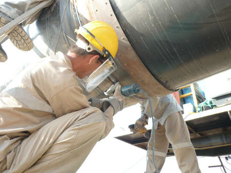 Welding of the pipeline. Process of creation of welding connection by the special mobile machine.