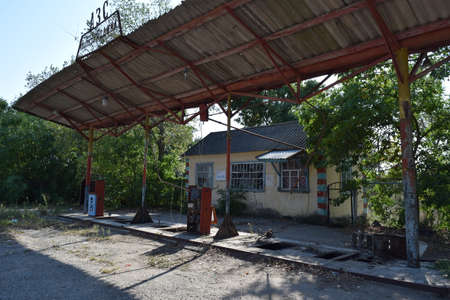 the thrown: The old thrown gas station. Structure of times of socialism. Stock Photo