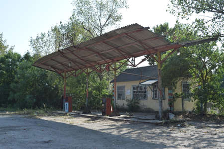 rudimentary: The old thrown gas station. Structure of times of socialism. Stock Photo