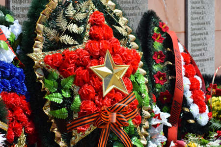 unknown age: VILLAGE POLTAVA. 9 May, 2015: The laid flowers to a monument in honor of a Victory Day on May 9. Patriotic traditions. Editorial