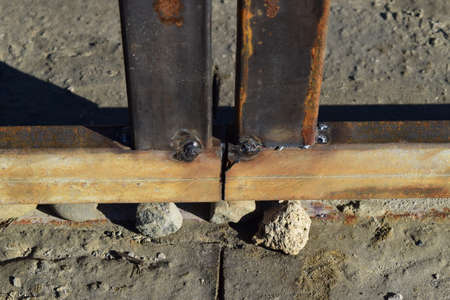 welding: Connection by welding of metal square pipes. Welding seam.