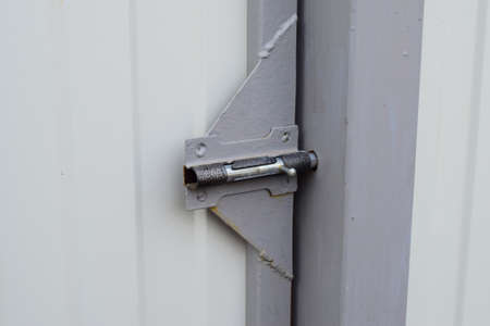 Latch on gate. A design for locking of gate from within. Stock Photo