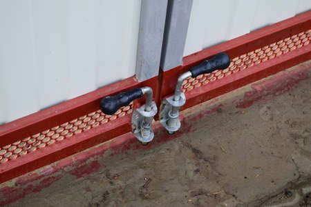 aluminum rod: Latch on gate. A design for locking of gate from within. Stock Photo