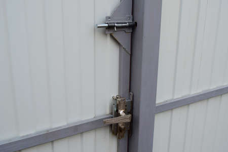 brass rod: Latch on gate and the lock with the handle. A design for locking of gate from within. Stock Photo