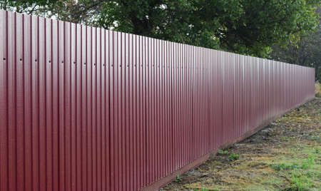 corrugated iron: Diagonal pattern of metal profile. Fences from the galvanized iron painted by a polymeric covering.