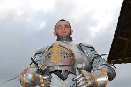 knightly: Knightly armor and weapon. Semi - antique photo. Stock Photo