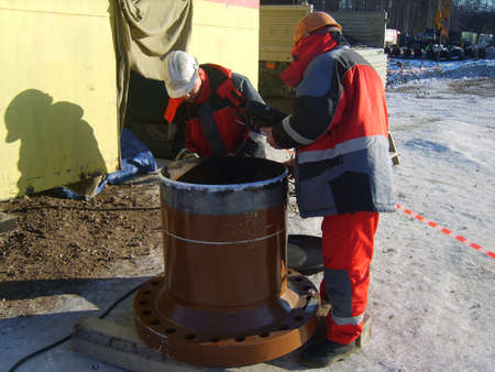 deconstruct: Sakhalin, Russia - 12 November, 2014: survey of quality of processing of future place of welding. Editorial