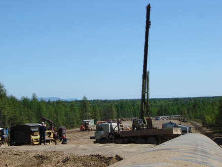 pressurized: Sakhalin, Russia - 12 November 2014: Construction of the gas pipeline on the ground. Transportation of energy carriers.
