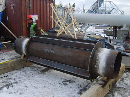 deconstruct: Sakhalin, Russia - 12 November 2014: Welding of a dyuker in a cartridge. Strengthening of a design of the pipeline. Editorial