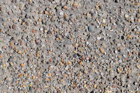 pellet: Pellet in old asphalt. Background texture of the old road.