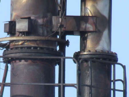 flange: Flange connections on gas flaring. Burning through a torch head. Stock Photo