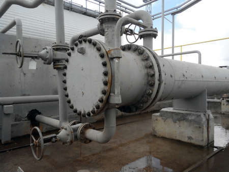 heat exchangers: Heat exchangers for heating of oil . Oil refinery. Equipment for primary oil refining. Stock Photo