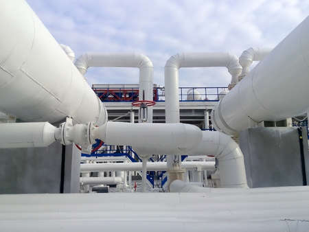 heat exchangers: Heat exchangers in a refinery. The equipment for oil refining. Stock Photo