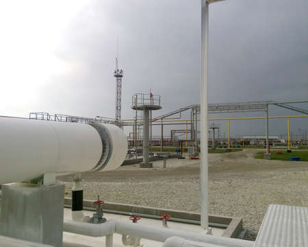Heat exchangers in a refinery. The equipment for oil refining. Stock Photo