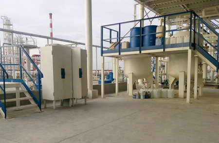 distillate: Tool box and a playground pouring chemical. The equipment for oil refinery.