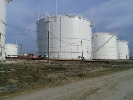 storage tanks: Storage tanks for petroleum products. Equipment refinery. Stock Photo