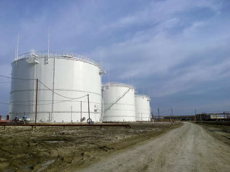 faction: Storage tanks for petroleum products. Equipment refinery. Stock Photo