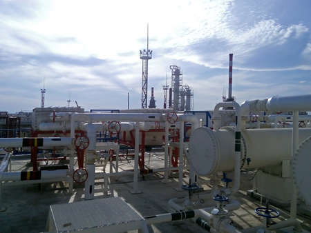 distillate: The oil refinery. Equipment for primary oil refining. Stock Photo