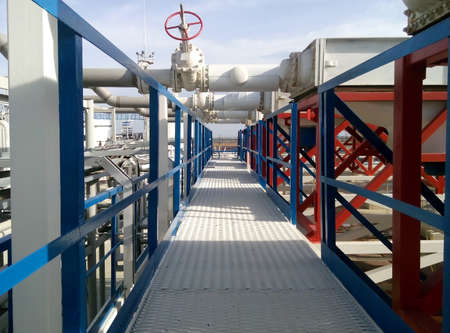 catalytic: Steel service platform and stairs. Equipment refinery.