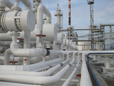 a faction: Heat exchangers in a refinery. The equipment for oil refining. Stock Photo