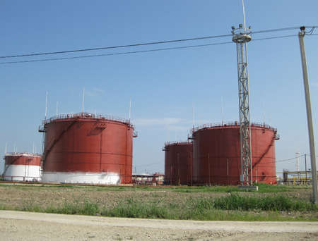 a faction: Storage tanks for petroleum products. Equipment refinery. Stock Photo