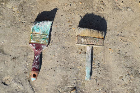unnecessary: Old oil dried brush. The old unnecessary things. Stock Photo
