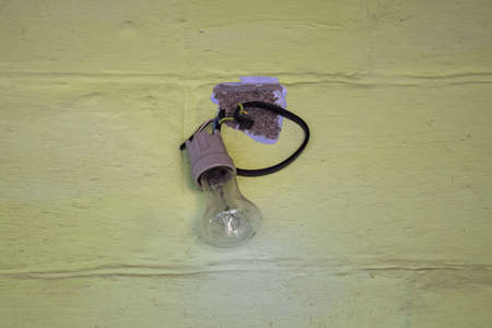 wiring: Old bowl with cartridge for light bulbs. Older wiring elements. Stock Photo
