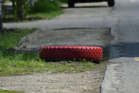 tread: Red tread wheels on the side of the road. Wheel Using a delimiter.