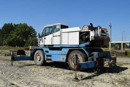 disassembled: The disassembled loader crane. Old machinery repair.
