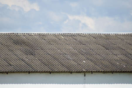 slate roof: The old slate roof against the sky. Elements of building constructions. Stock Photo